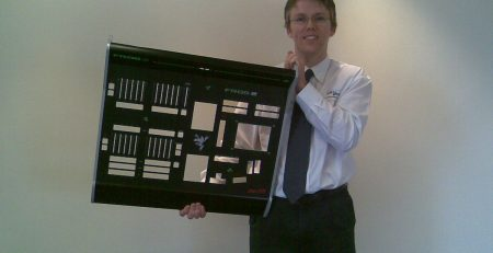 Staff photo of Paul holding large sheet metal fabricated part