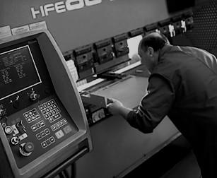 black and white image of man cnc folding