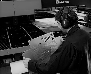 black and white image of a man cnc punching