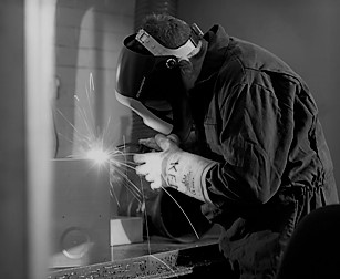 black and white image of a welder